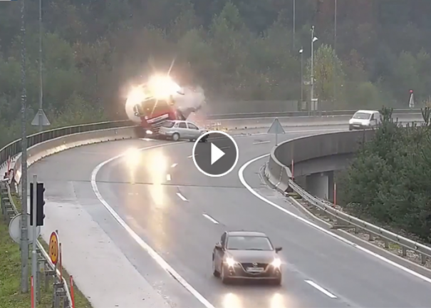 Car driver's swerve sends truck plunging off overpass in horrifying crash